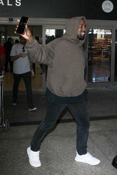 Kanye West wearing  Haider Ackermann Hoodie, Adidas Ultra Boost Shoes