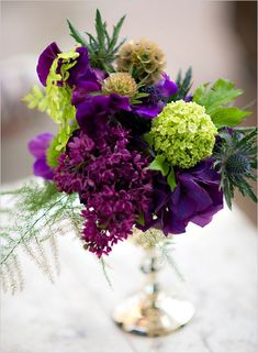purple and green wedding flowers Tablescape Centerpiece www.tablescapesbydesign.com https://www.facebook.com/pages/Tablescapes-By-Design/129811416695