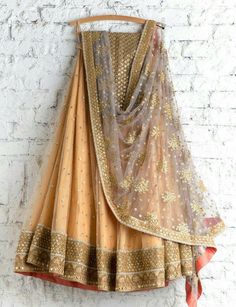 Shop designer net with famed embroidery lehenga choli online.This set is features a green blouse in silk embroidery and sequins work.It has matching beige lehenga in net with beautiful embroidery all over and brown dupatta in net. We ship worldwide to Yem Green Lehenga, Indian Lehenga, Lehenga Choli, Bridal Lehenga, Gold Lehenga, Lehenga Blouse, Sabyasachi, Indian Attire, Indian Wear