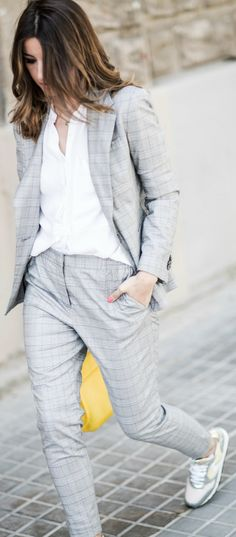 Alexandra Pereira's androgynous summer style + two piece suit + simple white tee + classic suit + edgy vibe + we adore!  Sneakers: Voile Blanche, Suit/Tee: Zara, Bag: Carolina Herrera.