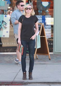 Peek-a-boo: Kirsten flashed a glimpse of her white socks that she wore underneath her rustic footwear