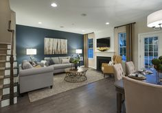 Saddlebrook Estates - The open floor plan gives the home owners a stylish yet comfortable great room to entertain or lounge. We love the dark hardwood floors with the bright white ceiling!