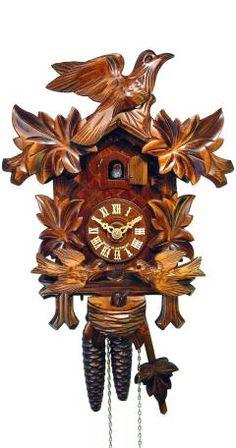 Reloj cucú4 follajes, pájaro que se balancea, nido. Fabricante: August Schwer Altura: 32 cm. / 12,6 pulg. Ancho: 18 cm. / 7,1 pulg. Profundidad: 15 cm. / 5,9 pulg. Color: Nogal Peso neto: 1,8 kg Peso bruto: 2,8 kg