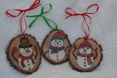 Set of 3 Woodburned and Hand Painted Snowman ornaments with a resin finish