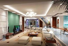 Specious beach style living room furnished with classy beige colored sofa elements . A low height wooden table placed at center having glass table top. Back side glass railing with wooden hand rail. Above raised ceiling with back light .