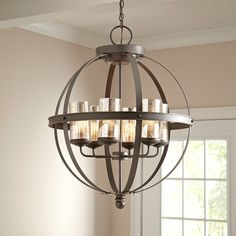 Cast a warm glow in your foyer or dining room with this lovely chandelier, featuring an open sphere design for visual appeal.  Produ...