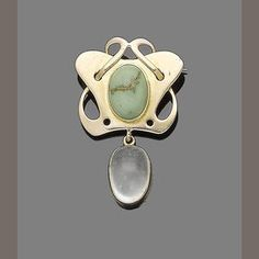 An art nouveau turquoise and moonstone brooch, circa 1910