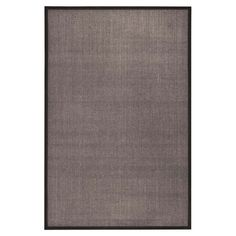 Anchor your living room seating group or define space in the den with this artfully woven rug, crafted from sisal for natural appeal.