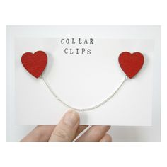 These heart shaped collar clips are perfect for brightening up any collared shirt - simply pin one heart to each side of the collar for a super cute look.    Each wooden heart is hand painted and varnished before being joined with silver plated curb chain. The wooden hearts each measure 2.5cm ...