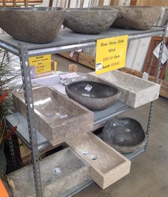 River Stone Sinks, each with unique patterns and colors. #SoutheasternSalvage #HomeEmporium #homedecor