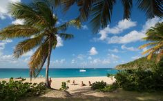 Happy Bay, St. Martin: North of Friar's Bay Beach on the French side of St. Martin, Happy Bay is a happily underpopulated stretch of vanilla sand. It's a hike to get there: 10–15 minutes on a well-marked footpath through the underbrush, which requires just enough effort to ensure the kind of privacy that has made it popular for those who prefer to sunbathe au naturel.