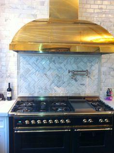 Gray and Brass -gorgeous brass hood - love the marble herringbone backsplash