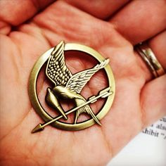"""Mockingjay pin from The Hunger Games """"May the odds be ever in your favor."""""""