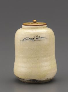 Satsuma ware tea caddy with landscape decoration  mid-19th century      Edo period or Meiji era. (ivory lid)  H: 9.0 W: 7.1 cm   Kagoshima, Japan .