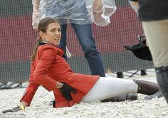 Charlotte Casiraghi grimaces after taking a tumble from her horse during the Paris Eiffel Jumping