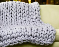 Have you heard about Arm Knitting? It is very popular nowadays.  It is a lot of fun and pretty easy. Even if you are new to knitting, with our detailed tutorial you can make a small blanket 25x30 within just one hour or less!  Download this Arm Knitting tutorial for Arm Knitting a 25x30 blanket and enjoy amazing Arm knitting.  You will need 2 lbs of Super Chunky Merino wool yarn for a blanket of 25x30 inches.  You can buy Merino Wool yarn at our store: https://www.etsy.com/shop...