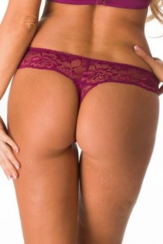 Sexy Lingerie  Sheer purple lace thong with pink accents, pink lining, scalloped trim, and front satin bow. Pair with matching bra for a complete look. 90% Nylon, 10% Spandex.
