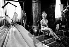 Photographer Gareth Cattermole captures the glamour of Haute Couture Fashion Week. A model admires her dress backstage before the Tony Yaacoub show on July 2, 2013 in Paris, France.
