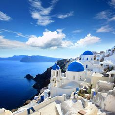 Blue-roofed houses in Santorini, Greece.