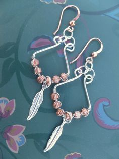 Wire Wrapped Earrings Lone Feather by GemRio on Etsy, $18.00