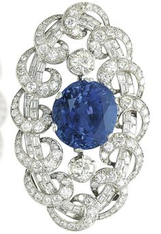 AN ART DECO SAPPHIRE AND DIAMOND BROOCH, BY MISSIAGLIA. Centring upon an oval-shaped sapphire to the circular-cut diamond shoulders, in a baguette and circular-cut diamond oval-shaped frame with scrolls, mounted in platinum, 1930s, 7.5 cm. Signed Missiaglia. #Missiaglia #ArtDeco #brooch