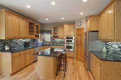 Gourmet Kitchen w/Granite, Hardwood floors, Custom Cabinetry, Walk-in Pantry