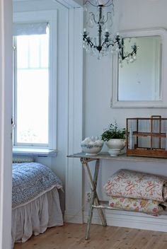 """I absolutely love an all-white palette with just a hint of warm earth tones like red and brown. The black and the crystals on the chandelier add the pop of """"Wow! Antique Decor, Vintage Decor, French Interior, Interior Design, Small Bedroom Designs, Vintage Interiors, Vintage Shabby Chic, Beautiful Bedrooms, Decoration"""