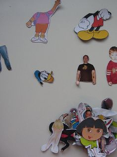 """Magnetic Personalities"" (Photos of family AND cartoon characters with tops and bottoms separated, glued onto magnetic paper — just for open-ended mixing and matching fun)."