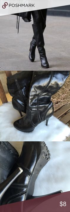 Madeline Stuart Boots Black over the knee boots with upper flap over. These boots are used and show some signs of wear, but still can stylish worn. I want to say the heel is at least 4 inches. Size is 9M. Feel free to ask questions. Madeline Stuart Shoes Over the Knee Boots