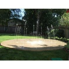 Backyard splash pad. How fun would this be?