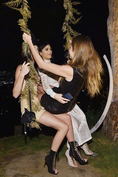 Kendall and Kylie Jenner made sure Olivier Rousteing's birthday bash was a night to remember.  The super excited sisters put on a playful display with Cara Delevingne as they hopped on a swing together.