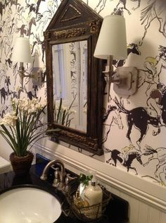 Hermes wallpaper in the powder room