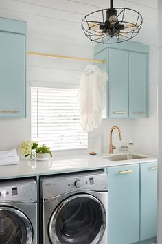 Tiffany's Blue Cabinet. Tiffany's Blue Cabinet Paint Color. Laundry room with matte brass hardware and Tiffany's Blue Cabinet. Tiffany's Blue Cabinet is Gossamer Blue by Benjamin Moore #TiffanysBlueCabinet #TiffanysBlue #Cabinet Soda Pop Design Inc.