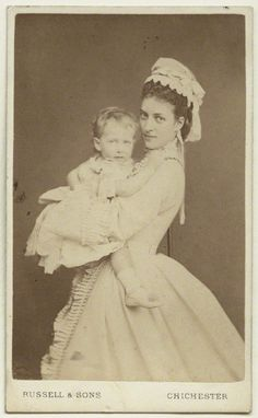 Alexandra, Princess of Wales (later Queen Alexandra) holding her fifth child and youngest daughter Princess Maud (later Queen of Norway)  by James Russell & Sons August 1872