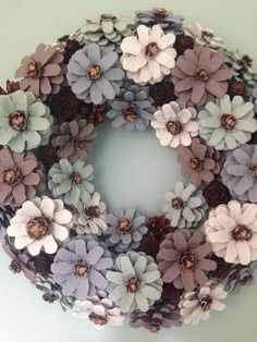Handcrafted pinecone door or wall wreath. Suitable for indoor or outdoor decoration. Each pinecone is handcrafted and individually painted then mounte Handcrafted pinecone door or wall wreath. Suitable for indoor or outdoor decoration. Pine Cone Art, Pine Cone Crafts, Wreath Crafts, Diy Wreath, Pine Cones, Door Wreaths, Pine Cone Flower Wreath, Painted Pinecones, Pine Cone Decorations