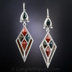 Vintage Scottish Agate Drop Earrings. We see a lot of kilt pins and occasional bracelets but vintage Scottish earrings are exceedingly scarce. These sleek kite shape adornments are inlaid with contrasting deep teal bloodstone and sienna hued jasper and measure almost 2 inches long including the ear wire. Hand fabricated in silver, circa early-20th century.