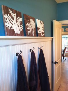 I want to to my kids' bathroom with beadboard a shelf like that and a darker wall color. PERFECT!