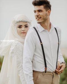 Image may contain: 2 people, people standing Wedding Hijab Styles, Bridal Hijab, Hijab Bride, Muslim Wedding Dresses, Wedding Suits, Pre Wedding Photoshoot, Wedding Poses, Wedding Couples, Turban Style