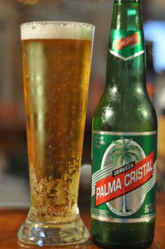 Cerveza Palma Cristal ~ While this is not the most popular beer on the island, it is the beer with the best reputation around the world. Palma Cristal is not a world class lager by any means, but it is perfect for the hot tropical heat of Cuba. #Cuba #Beer #Palma_Cristal