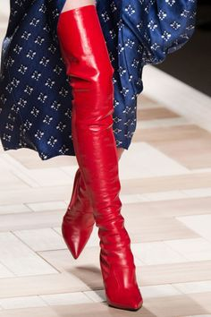 Fendi | Red hot over the knee boots paired with almost every look walking down the runway - HarpersBAZAAR.com