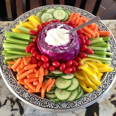 Fruit and veggie tray with purple cabbage for dip! Genius! And I love the colors!                                                                                                                                                                                 More