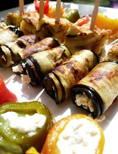 3 appetizers-eggplant rolls with feta cheese; Potato tortilla squares; sweet Pepper Rolls w/Ricotta