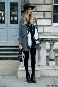 Fifi Newbery of Fifi's Looking Glass wears a Topshop hat, a black and white Hang 'n' Hold scarf, and a classic gray The Kooples coat.