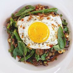 "#tghollywood Steak & Spicy Garlic ""Fried Grain Bowl"", Farro, Roasted Corn, Green Beans, Charred Tutti Fruitti Farms Red Cabbage & Onions, Thai Basil, Cilantro, Fried Organic Egg #california #losangeles #hollywood #sunsetandvine #dinela #laeats #tuttifruttifarms #farmtotable #foodie #foodstagram #cheflife #grains #farro #steak  #egg #bowl #brunchfood #sundayfunday #yummy #comeandgetit"