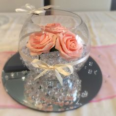 Fish bowl wedding centrepiece for pink themed weddings. Clear beads and pink roses. Available to hire for your wedding in Swansea, Neath, port talbot, Bridgend, porthcawl, Llanelli, Carmarthen and surrounding areas of South Wales from affinity event decorators www.affinityeventdecorators.com