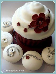 White with red flower accents  #wedding cupcakes ... Wedding ideas for brides, grooms, parents & planners ... https://itunes.apple.com/us/app/the-gold-wedding-planner/id498112599?ls=1=8 … plus how to organise an entire wedding ♥ The Gold Wedding Planner iPhone App ♥