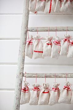 Make this fun Christmas Countdown by hanging DIY grain sack bags on a ladder made from logs.