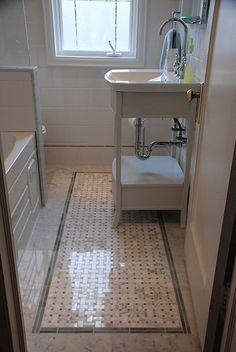 I like the inlaid tile, to look like a carpet. Very Sarah Richardson.