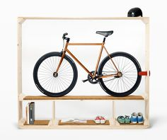 Shoes, Books and a Bike can serve as a room divider in an open plan space or a studio apartment. One of the nice features over most of the existing bike racks is there is no need to drill holes in a wall or ceiling for hanging hardware. Shoes, Books and a Bike is self contained.