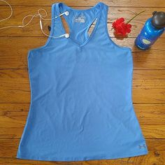 Under Armour Tank This Under Armour tank is NWOT. I love the color and style but it's just the wrong size for me! 90% polyester 10% elastane Under Armour Tops Tank Tops